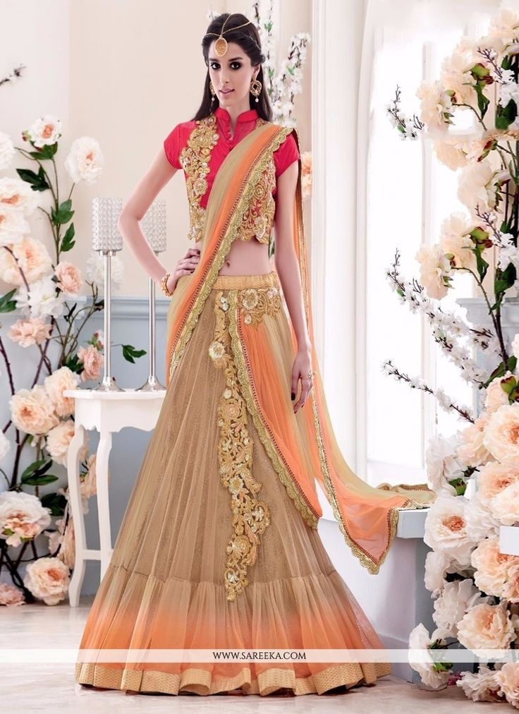 Add richer looks to the persona in this majestic beige net lehenga saree. You can see some fascinating patterns completed with embroidered and patch border work. Comes with matching blouse. (Slight v...