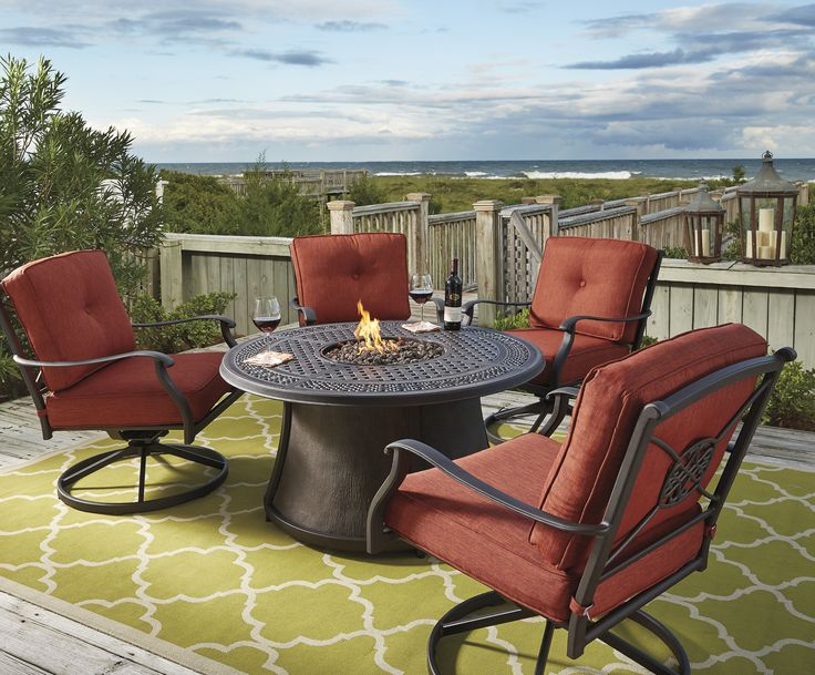 Outdoor parties time! Celebrate 4th of July together with FurniturePick! Enjoy spending hours around the handsomely crafted Burnella Round Fire Pit Table Set by Ashley.   #outdoor_set #fire_pit #Ashley #furniture #patio #terrace #cushions #round_table #all_weather #outdoor_furniture #furniture #4th_of_July