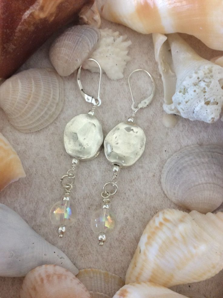 Hammered silver plate and opalescent bead sterling silver leverback earrings. by SandtoSummitDesigns on Etsy https://www.etsy.com/listing/497154429/hammered-silver-plate-and-opalescent