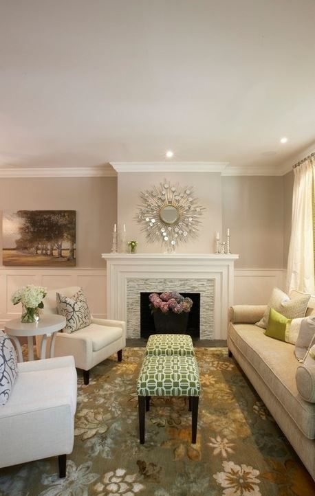 Loving the gorgeous mirror above this fireplace and those fun, patterned ottomans. Paint color: Benjamin Moore Muslin