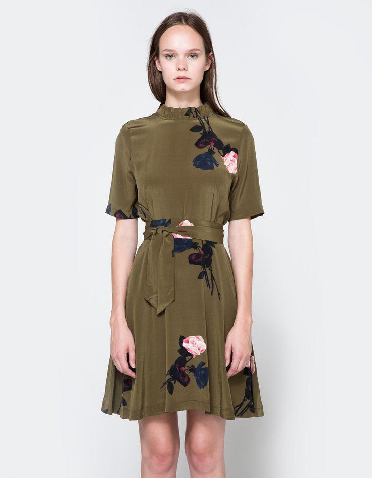 From Ganni, a lightweight silk dress in Dark Olive. Round collar. Ruffle…