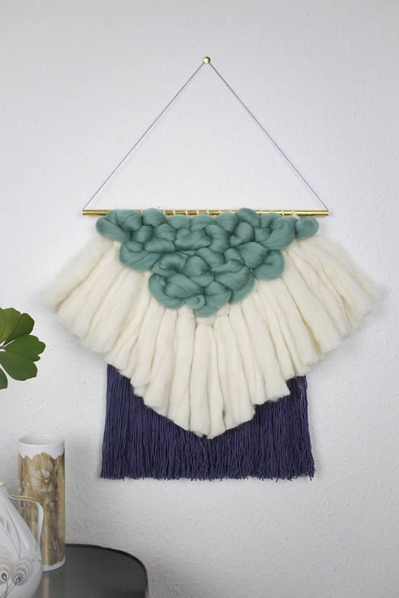 Super soft and fluffy wall hanging with a minimalistic geometric design. Its handmade woven on a loom by me from high quality merino wool and lightweight cotton. This wall hanging looks nice in your living room or bedroom and adds some extra coziness to every nursery. The main