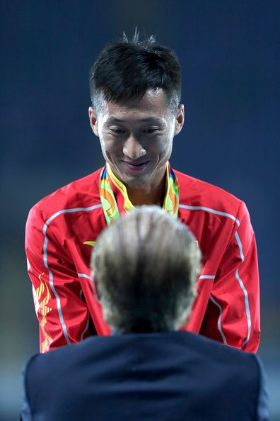 #RIO2016 Zhen Wang of China is presented with the gold medal for Men's 20km Race Walk by IOC member Willi Kaltschmitt Lujan on Day 7 of the Rio 2016 Olympic...