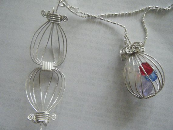 Hey, I found this really awesome Etsy listing at https://www.etsy.com/listing/118196397/silver-wire-locket-wcrystal-beads