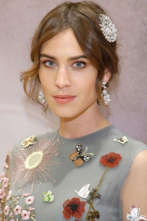 Hairstyles to try this holiday season: Alexa Chung barette and soft curls.