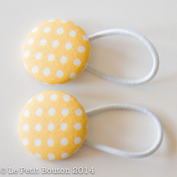 1 pair of 28mm gorgeous designer yellow polkadot fabric covered button hair ties.