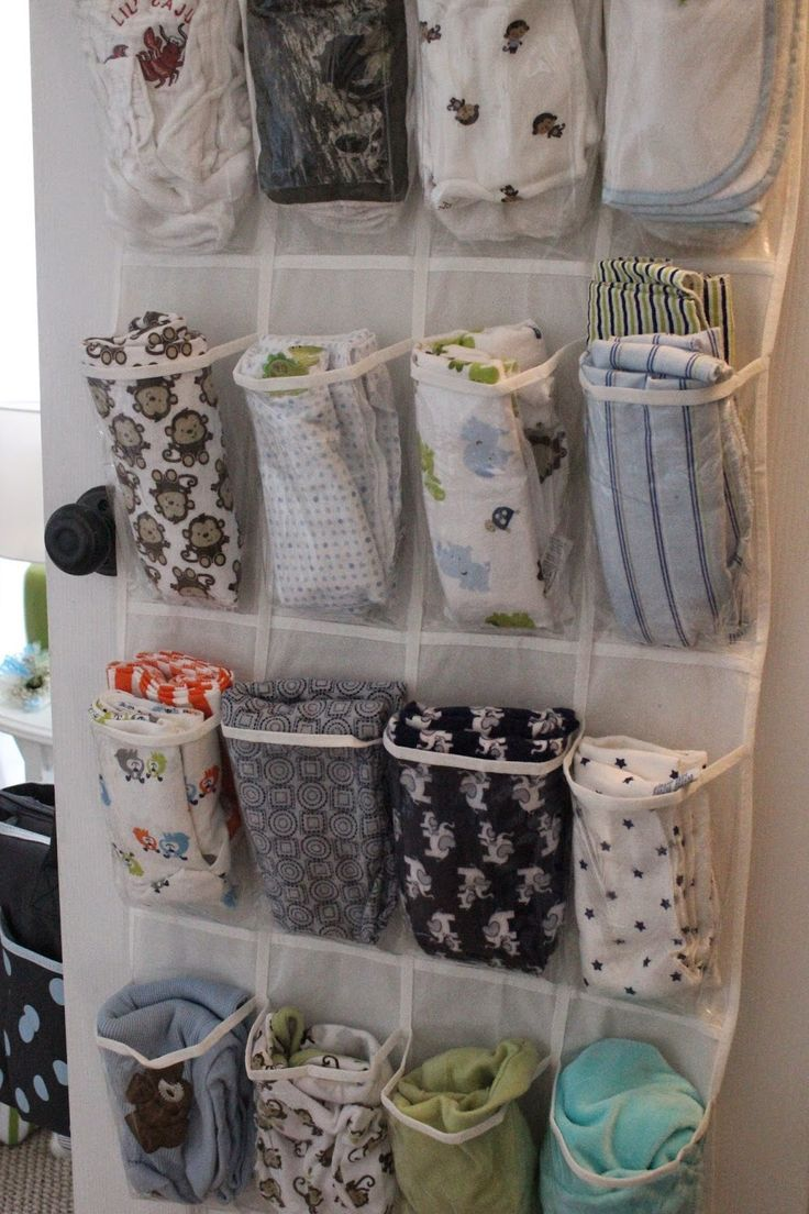 Store baby blankets and/or burp cloths in a shoe organizer on the back of the door.  Pin found by Freebies-For-Baby.com