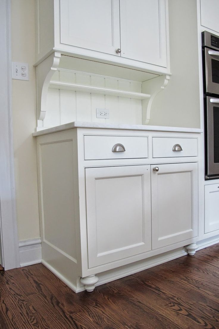 I love the little feet that make the cabinet look like for Kitchen cabinets that look like furniture