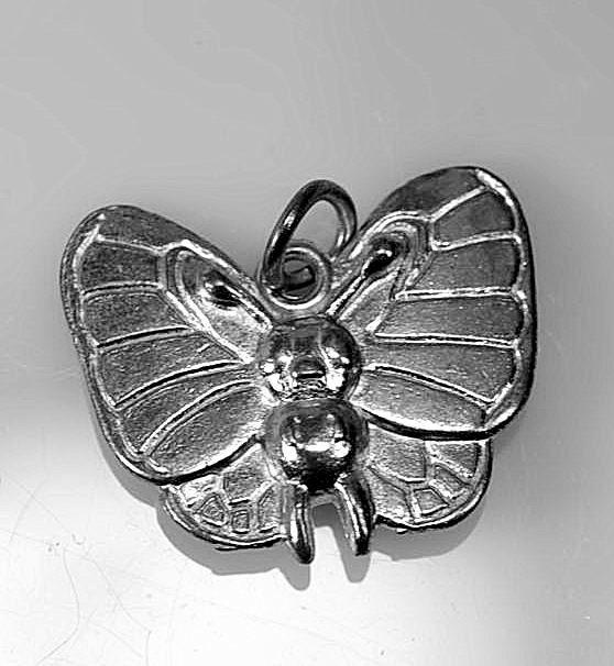 Butterfree Butterfly flying type Pokemon Sterling silver .925 cute charm jewelry. $25.00, via Etsy.