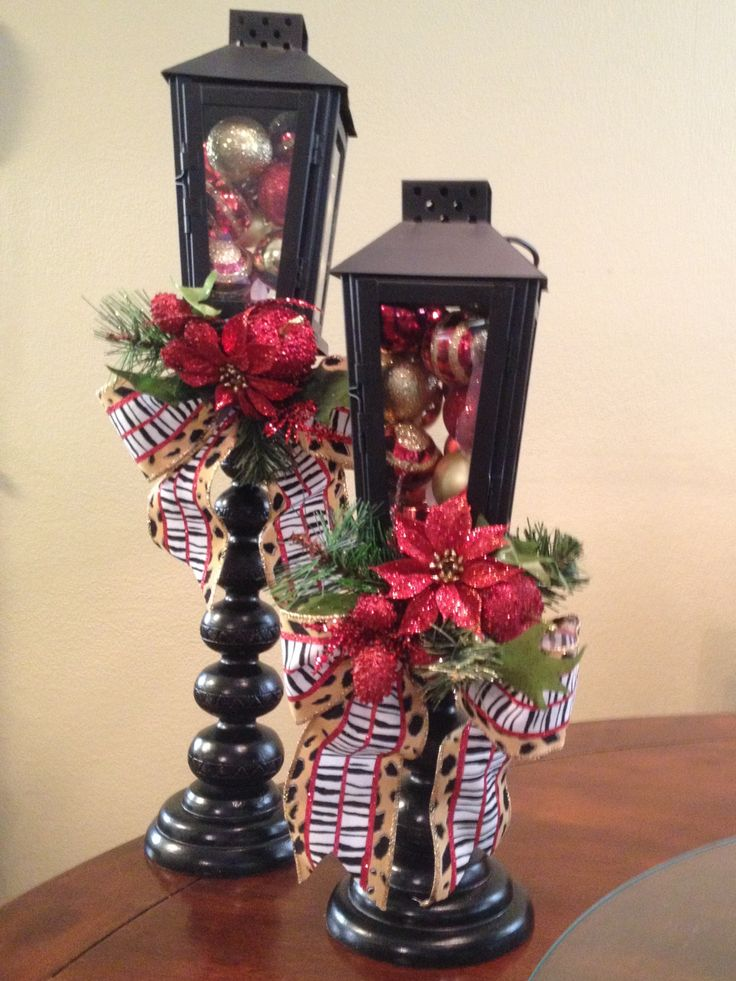 Christmas lantern decorations! Old candlesticks glued onto cheap lanterns from Lowes. So cute and easy to make! LOVE :)
