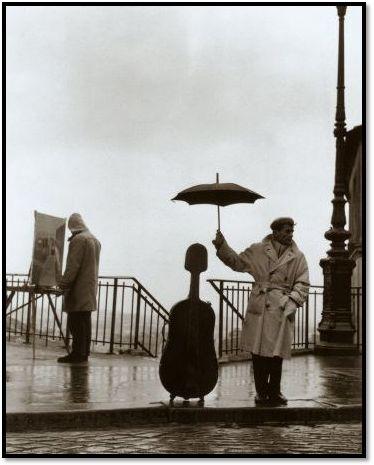 Musicien sous la Pluie ©Robert Doisneau