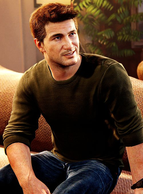 Nathan Drake from Uncharted series. Wearing dark green jumper and dark blue jeans