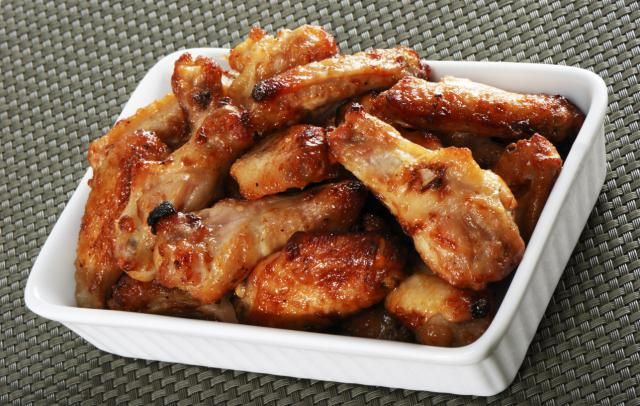 Take a break from traditional Buffalo wings with this sweet and spicy mustard-glazed chicken wings recipe. It's a super-easy party snack that needs no dip.