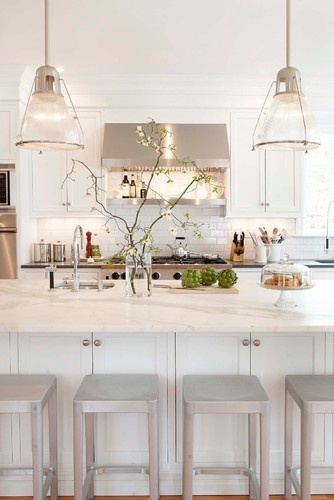"Cabinets are pure white; walls of kitchen are Benjamin Moore ""Edgecomb Grey""; subway tiles are classic white with Silverado grout; marble on island is calcutta gold"