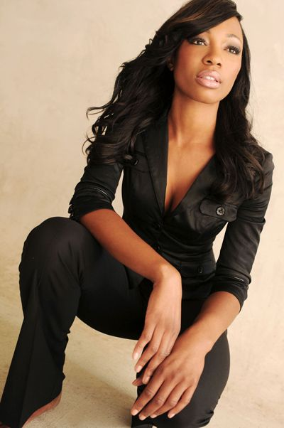 Cari Champion in a black 3/4 sleeve fitted shirt.