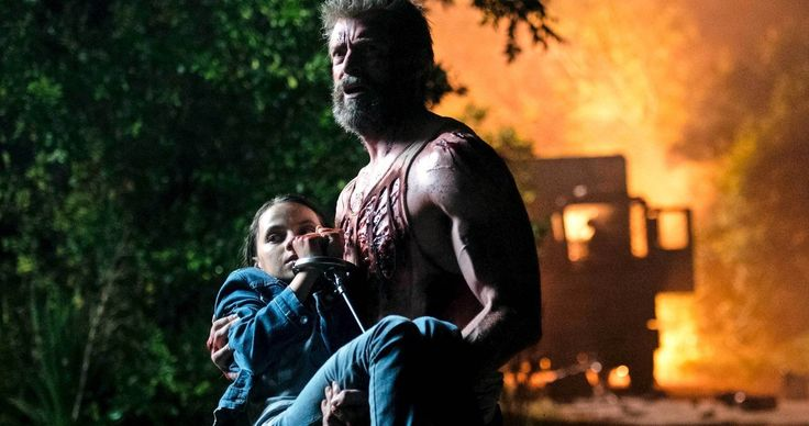 Logan and X-23 Escape an Explosion in Latest Wolverine 3 Photo -- Get a closer look at Hugh Jackman's Logan shielding the young mutant X-23 from danger in the first of two new photos from Wolverine 3. -- http://movieweb.com/logan-wolverine-3-photo-x-23-explosion/