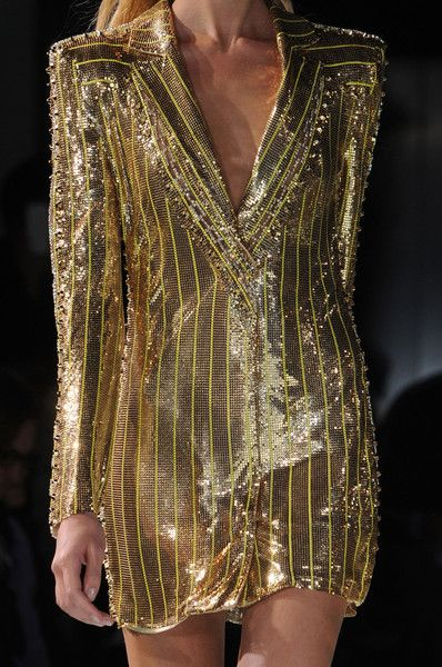 .....beautiful gold suit.  would look amazing with some big hair and some of the other makeup inspiration on this board.