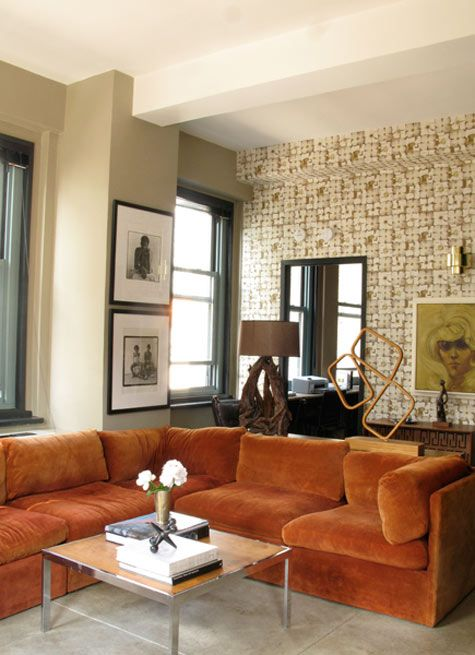 """Graphic wall paper, modern sculpture, burnt orange crushed velvet sectional - this is my 1970's dream home. From Design Sponge's """"The Best of Orange"""" series.    I love sectionals...and orange!"""