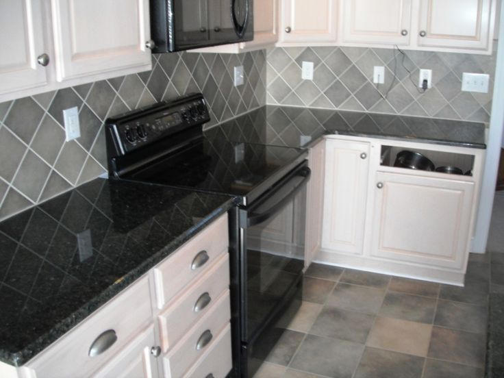 Amazing Kitchen Daltile Granite Uba Tuba White Cabinets With Roman Flango Diamond Backsplash Tile Also Black Modern Stove In Modern Kitchen Ideas Great Uba Tuba Idea - Popular black granite tile In 2019