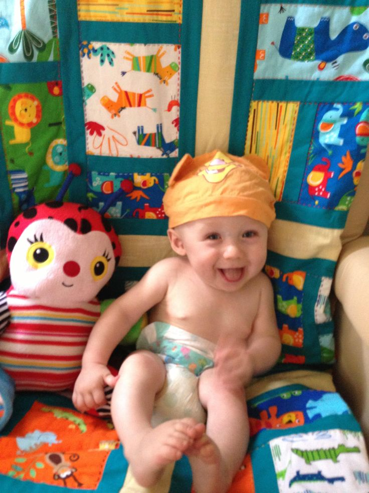 Adorable great nephew seems to like the animal quilt I made for him.