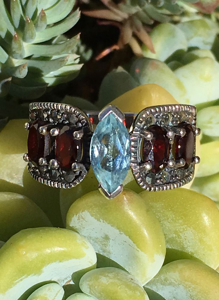 Ring Blue Topaz & Red Garnet in Sterling Silver Size: 8