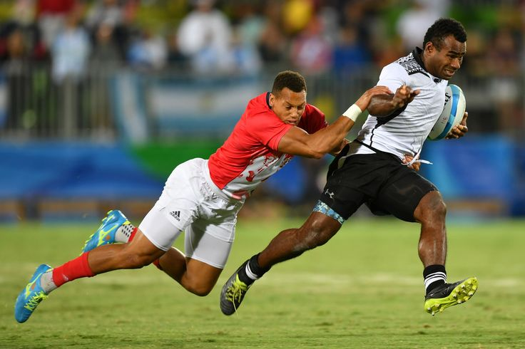 Fiji's Leone Nakarawa is tackled by Britain's Dan Norton in the mens rugby sevens gold medal match between Fiji and Britain during the Rio 2016 Olympic Games at Deodoro Stadium in Rio de Janeiro on August 11, 2016. / AFP / Pascal GUYOT
