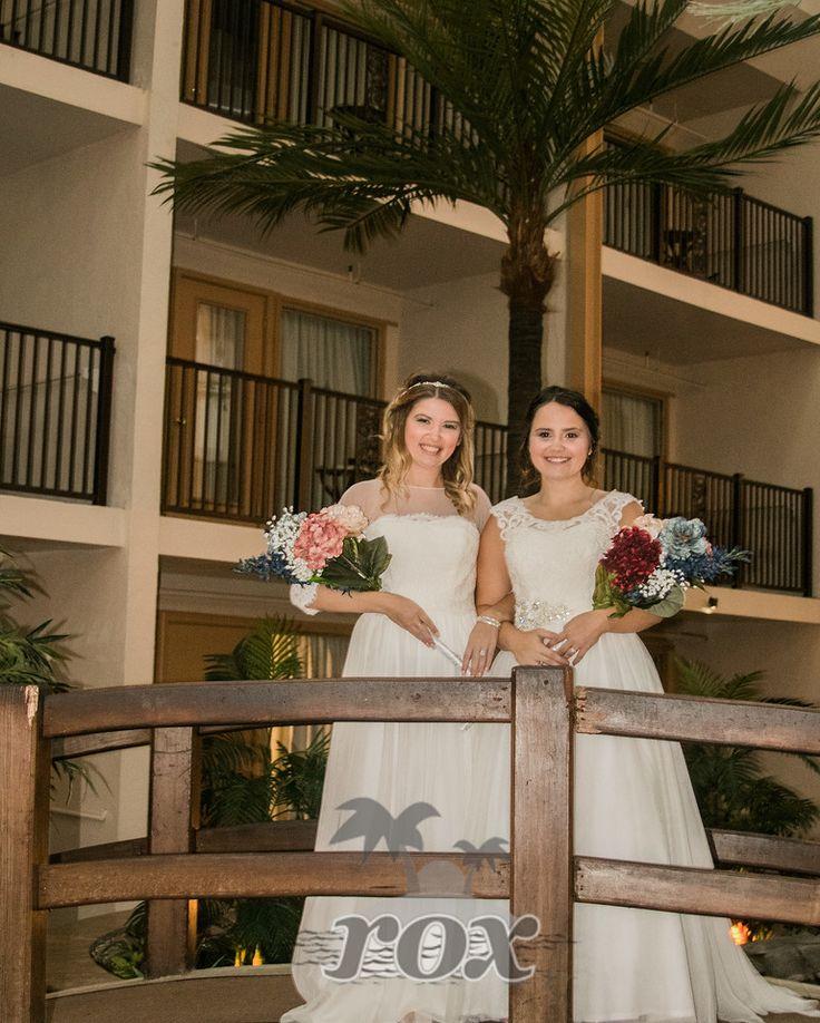 Two brides at the Quality Inn atrium after wedding on Ocean City, MD's 54th st. beach: https://www.oceancitybeachwedding.com/