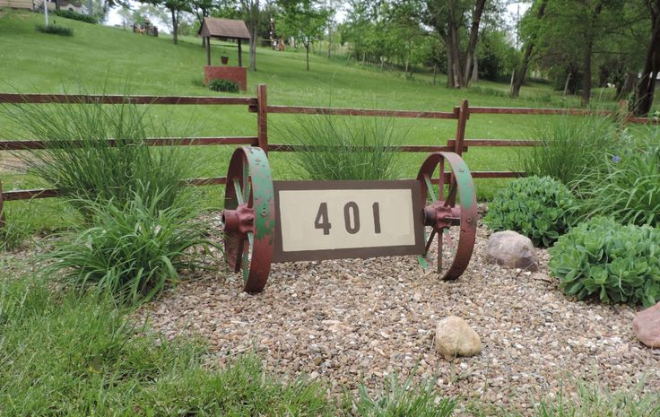 I have two matching antique iron wheels.  I decided to cut out a piece of wood where the sides would fit into the center of each wheel and made a house address sign to sit near the road. Unique yard art.
