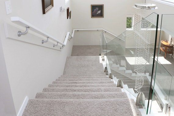 Carpet Quality stairs with frameless glass balustrade