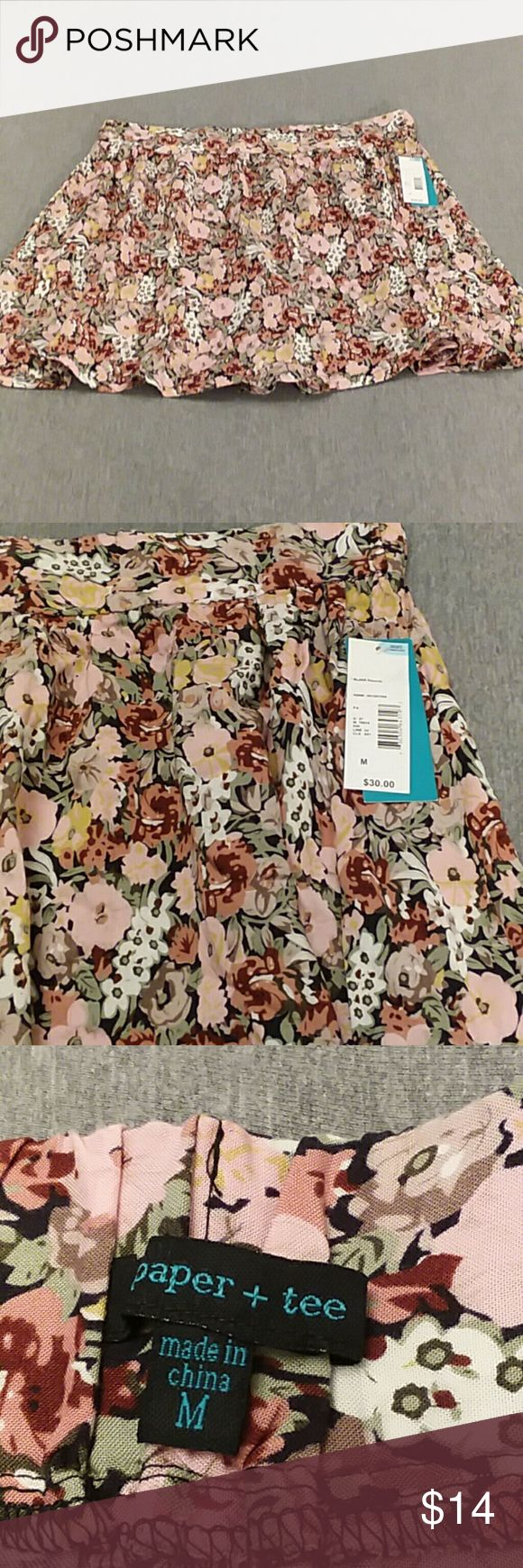 NWT PAPER + TEE Women's Floral Skirt medium NWT women's Paper + Tee beautiful medium floral skirt, elastic back waist band, pull on, flair skirt.  Colors of pinks, black, white, greens.  Clean, smoke free home. Paper + Tee Skirts Midi