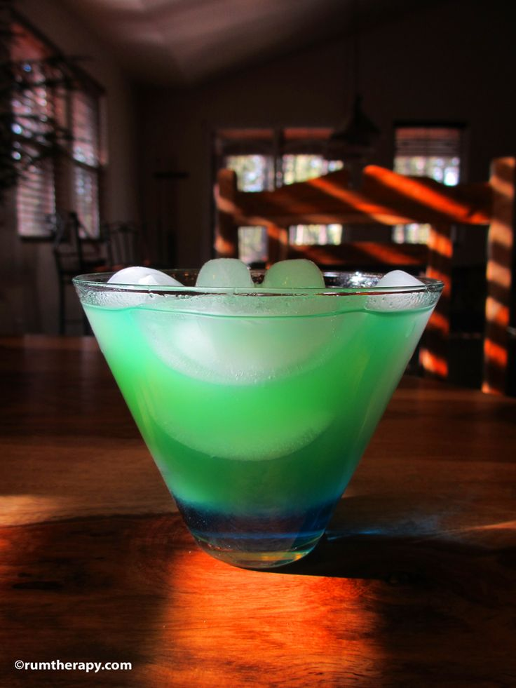 Tropical Leprechaun -  2 oz. Coconut Rum   .5 oz. Blue Curacao Liqueur  Pineapple Juice    Using a rocks glass full of ice, pour in the rum and Blue Curacao, then top it off with pineapple juice. Stir the top slightly, leaving the blue on the bottom of the glass – until the drink turns green.