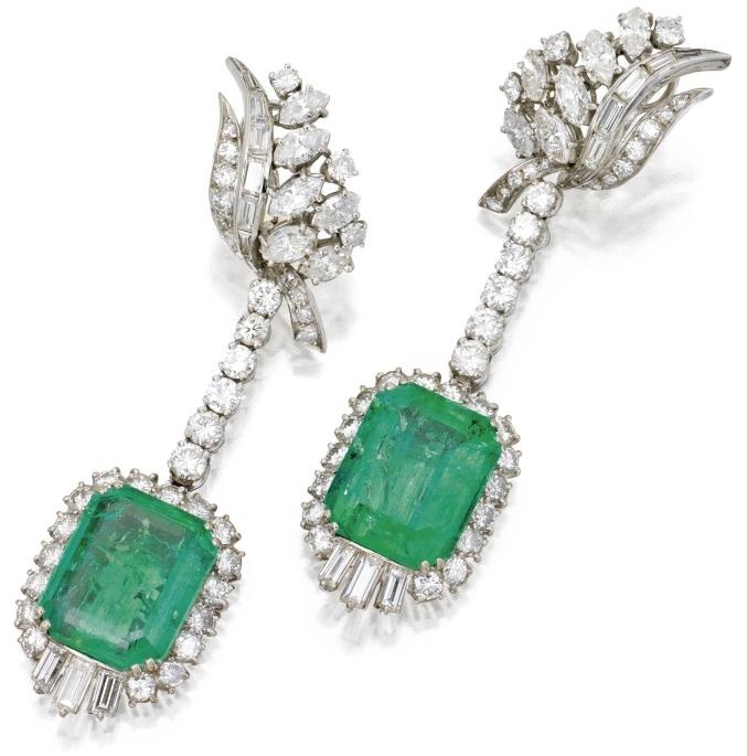 Emerald and diamond earclips, circa 1950. Round, marquise and baguette diamonds weighing approximately 6.00 carats, emerald-cut emeralds weighing approximately 25.70 carats, mounted in white gold.