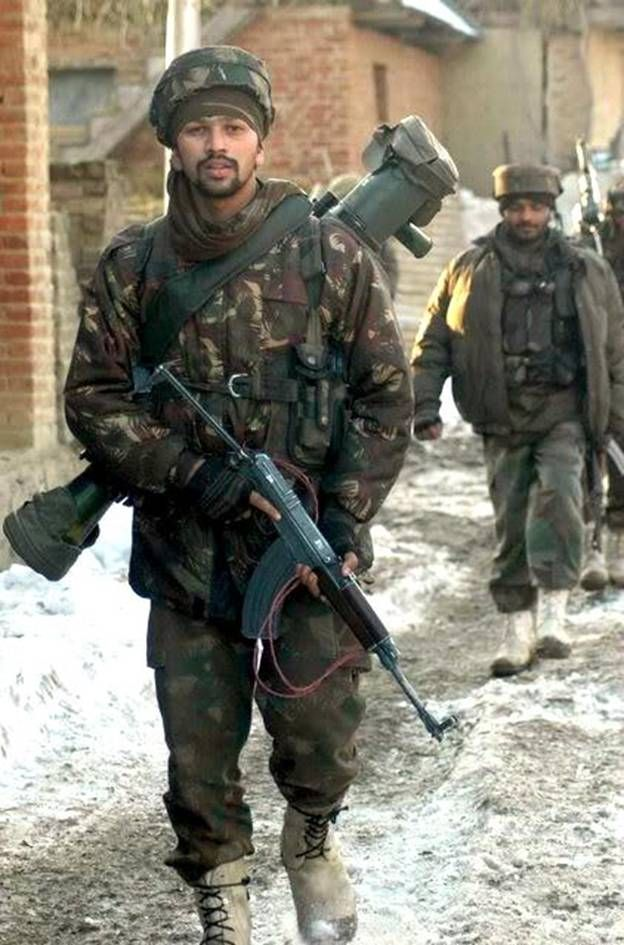 Indian Counter Terrorist member with the VZ-58 rufle and Carl Gustav Anti-Tank Rifle.