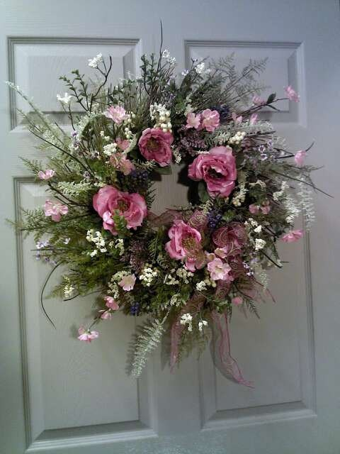 I like the look of this one.  HINT HINT.  Grapevine wreath dried look with roses