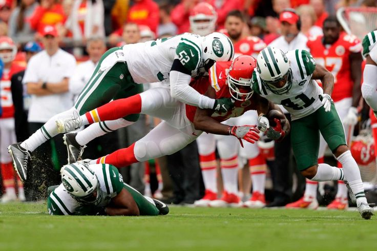 Tight end Demetrius Harris of the Kansas City Chiefs is sandwiched between middle linebacker David Harris and cornerback Buster Skrine of the New York Jets at Arrowhead Stadium during the first quarter of an NFL game in Kansas City, Mo., Sunday, Sept. 25, 2016.
