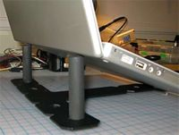 Top 10 DIY Laptop Stands -- I like either the PVC pipe one, or the one made from a wire mesh document organizer. I need to make this!!!