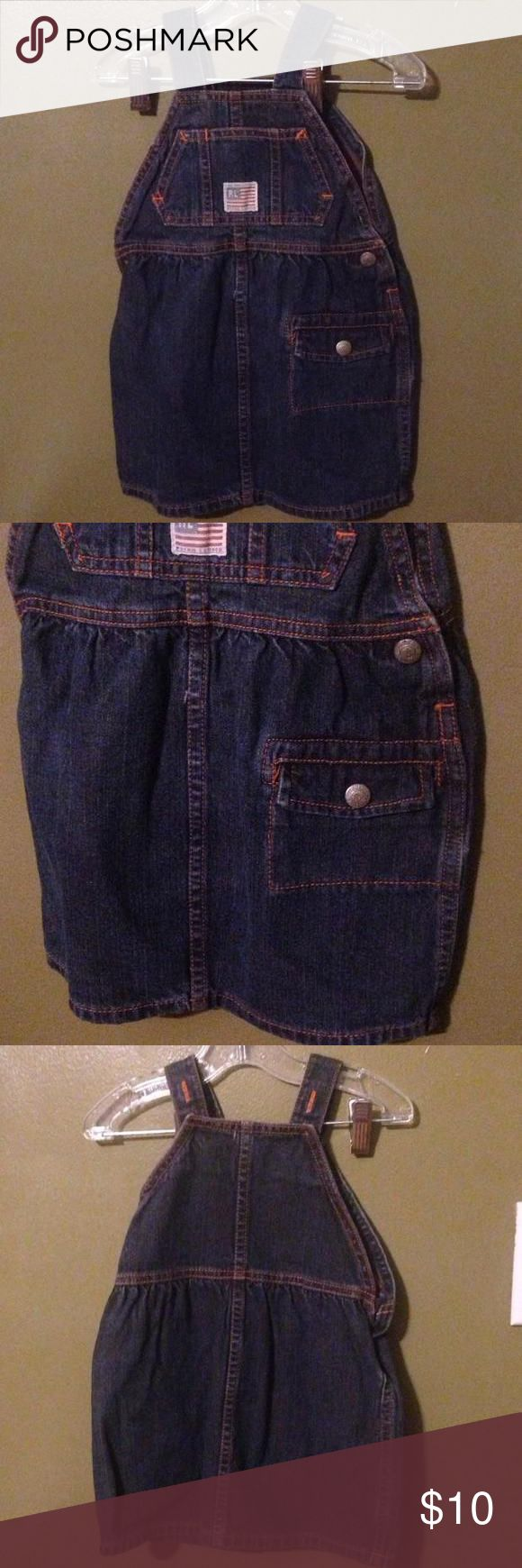 Polo Jeans Company Ralph Lauren overall set ~ size 6-12 months Cute blue jean overalls dress size 6 through 12 months. lined with orange stitching with a small decorative pocket on the front to hold the little ones treasures. The straps are adjustable as seen in the last picture and will help you get lots of wear. Ralph Lauren Dresses