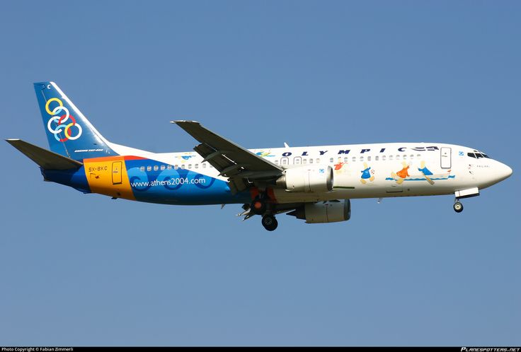 Olympic Airlines Boeing 737-484 SX-BKC aircraft, with the stickers of ''Φοίβος & Αθηνά'' mascots of Ο.Α. 2004 on the airframe, on short finals to Suisse Zurich Kloten International Airport. 28/03/2004.