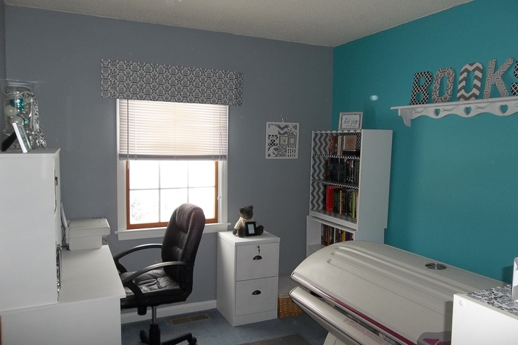 My home office redo.  Gray with accent teal wall.  White furniture makes a very calm atmosphere.
