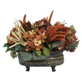 Set a romantic centerpiece or add lush style to your console with this silk hydrangea and banksia arrangement, showcasing an array of blooms and leaves in a footed metal pot.   Product: Faux floral arrangementConstruction Material: Silk, plastic and metalColor: Brown and rust - More Great Ideas from DriedDecor.com