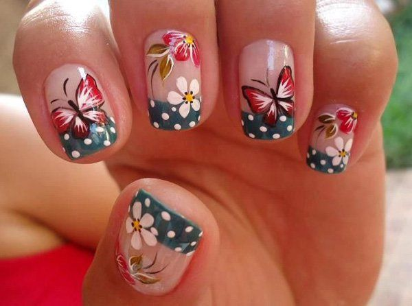 Another amazing looking butterfly nail art design! The midnight blue French tips are added with white polka dots while the nails are further adorned with white flowers. Red butterflies can be seen flying all around the flowers.