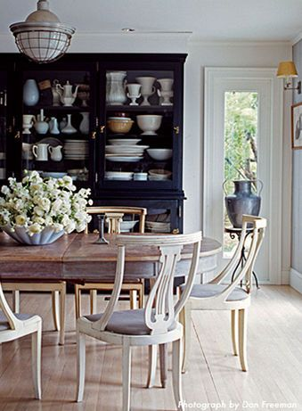 Love the dark storage cabinet in this dining room