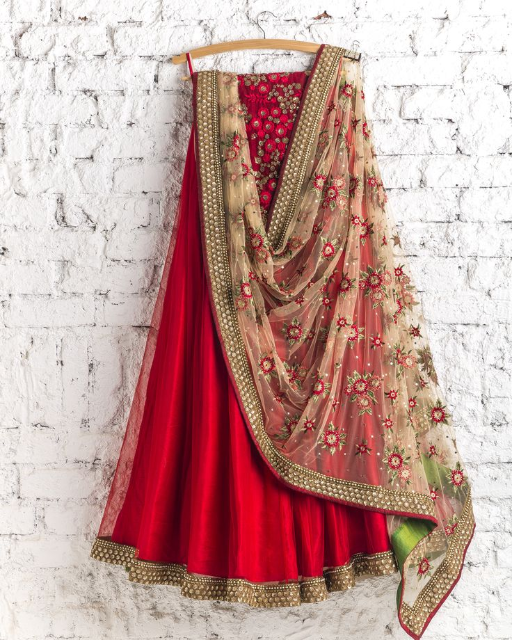 Scarlet lehenga with floral dupatta makes for a nice modern Indian bride look - pair this indian wedding lehenga with traditional jewelry for a classic look