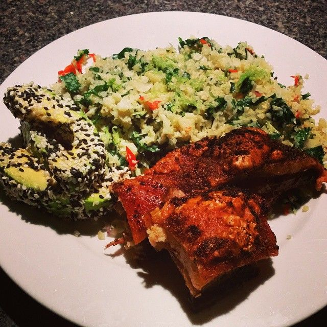 Free range pork belly,cauli rice with spinach and chilli and sesame crusted avo  #cleaneating #protein #vegegoodness #glutenfree #primal #greengoodness #cleaneats #primalfood #mmmspicy #chilihot #primaleats #freerangepork #grainfree #paleo #wholefoods #homegrownveg #paleomad #paleoeats