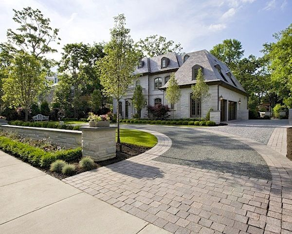 Driveway Design Ideas include a design at intersecting points of your driveway to create a focal point commonly chosen items are compass designs logos address numbers Curb Appeal Brick Drivewaycircle Driveway Landscapingdriveway Designdriveway Ideascircular