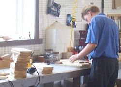 Unposed Amish woodworker photo is generally considered alright by church rules.