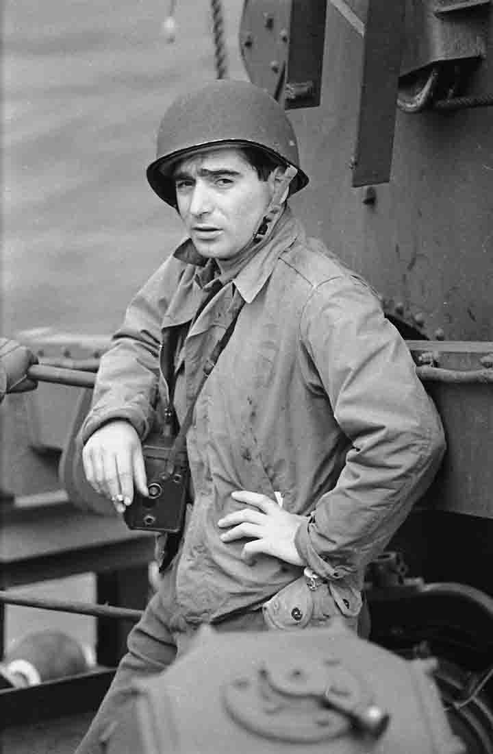 Robert Capa on D-Day, Hungarian War Photographer and Photojournalist. Co-founder of Magnum Photos in 1947. (Born Friedmann Endre - October 22, 1913 – May 25, 1954 (aged 40) in Thai Binh, State of Vietnam. Uncredited