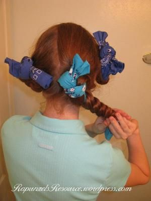 Bandana curls.  I've used rags as curlers for a long time since it's one of the only ways my hair holds curls.  It's so long now, though, that it doesn't work as well.  This page shows a different way to wrap your hair that works VERY well.  Her whole site has a lot of good hairstyles on it.