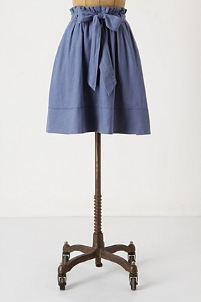 A line skirt with draw string waist and big bow. I think I could easily sew it!