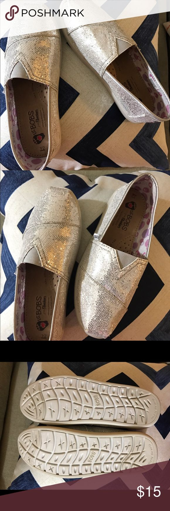 Very nice SKECHERS KIDS Bobs Kid  Glitter Textile Very Nice Skechers Lil Bons . Add some sparkle and shine to every outfit with these sweetly stylish shoes. Glittery fabric upper. Slip-on design for easy on and off. Skechers Shoes Flats & Loafers